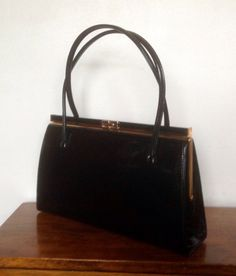 A Classic Large Black Patent Leather Handbag With Gold Clasp And Trim Beige Suede Lining