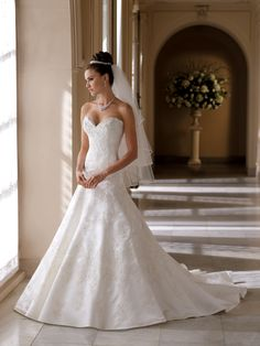 David Tutera for Mon Cheri. Strapless satin and lace A-line gown, sweetheart…
