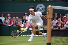 Roger Federer digs out a low volley during his second round match gainst Fabio Fognini. - Matthias Hangst/AELTC