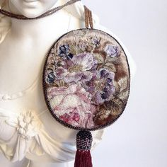 Inspired by the works of the old masters, textile artist Maria Vasilyeva creates accessories that evoke the style and fine workmanship of the Renaissance.