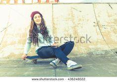 Hipster skateboarder girl with skateboard outdoor at skatepark. Skatebord at city, street. Cool, Funny Tenager. Half-pipe. Skateboarding at Summer. School, schoolgirl