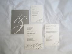 Love this modern, sleek wedding invitation suite printed on metallic paper