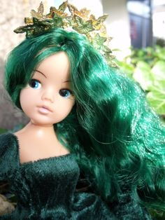 Pre Raphaelite Sindy by Claire. Photo pinned from My Little Customs, online shop for rerooting supplies. Sindy's hair here has been rerooted in Poison Ivy.