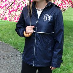 A stylish feminine fit. This classic Rain Jacket is the perfect piece for those wet and windy days! Both wind and water proof, and lined with grey mesh for air-flow circulation. * Hooded * Shockcord drawstrings. * Reflective stripe accent on front & back. * 2-way front