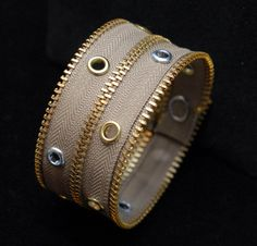 Zipper Cuff made from repurposed zippers, snaps and eyelets (by URArtsy on Etsy)