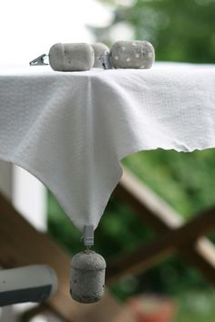 concrete tablecloth weights.. instructions ..Ferrero Rocher container. These would be great to hang from your tent to help keep the rain from pooling at the corners, during an outdoor art show.