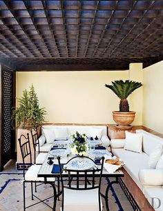 Alfresco dining is done right on the roof terrace of a dazzling home in Essaouira, Morocco.