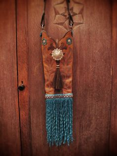 Queen of the Rodeo single boot top purse. Adornments of the most beautiful silver plated conchos, horsehair tassel and the strap is a Circle Y headstall with basket weave tooling. Butter soft turquoise deer skin leather fringe. Fully lined with a whimsical boot print cotton fabric. Sold at BlueGypsyStudio.com or on ETSY.com