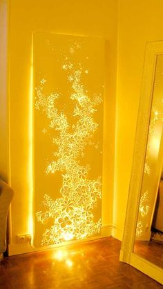 Buy any canvas, cut out a pattern, then string lights behind it - I MUST DO THIS FOR MY DOOR!