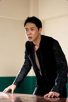 """JYJ's Yoo Chun is perfectly portraying a detective in the drama series Missing You.    On November 13, C-Jes Entertainment, Yoo Chun's agency released some snapshots of Yoo Chun from the series. In the snapshots, Yoo Chun is about to hit a prisoner at a police station.    A spokesperson for Yoo Chun says, """"Yoo Chun is showing off a charismatic look as a detective in the series. There will also be a lot of action scenes of Yoo Chun, so please don't miss them."""""""