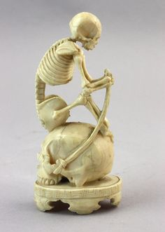 A macabre and unusual Japanese Okimono and another similar Okimono, Meiji period (1868-1912)