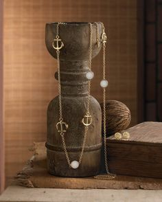 """Anchors aweigh! Your style will set sail when you add this pretty Nautical Jewelry Set featuring a golden chain with anchor charms and white discs and matching anchor button earrings. Necklace: 35"""" lo"""