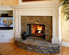 love the white mantle and stone @Erin B Doty Scoville how bout this for your fireplace (notice packers on tv lol)