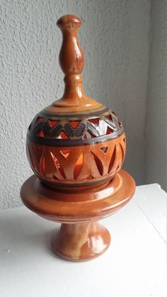 * A handmade clay pottery candle holder made by Egyptian Artisans. Thistle Flower, Egyptian, Candle Holders, Artisan, Pottery, Clay, Vase, Candles, Handmade