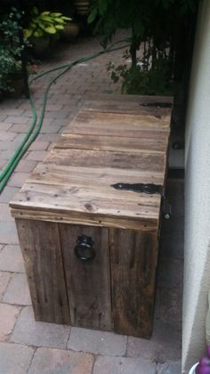 Old cedar wood fence recycled to make a storage box