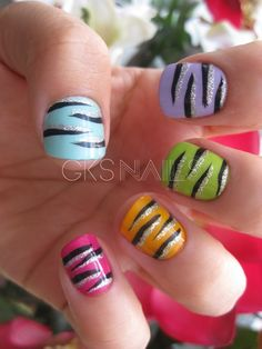 Cool colored tiger striped/glittery nails!