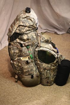 "Backpack can be taken off the vest and worn using the MOLLE shoulder strap and hip belt. Note the spinal curve of the pack which is ""built in"" to the pack itself."