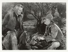 RED RIVER (1948) - Walter Brennan tends to a gunshot wound suffered by John Wayne - Directed by Howard Hawks - United Artists - Publicity Still.