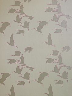 Ibis Wallpaper An elegant flock of birds in silver with an outline of shocking pink, flying across a grey sky.