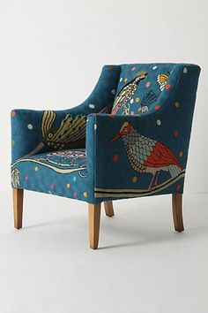 Adore this Anthropologie chair. If you look at a back view, it has an ostrich on the back! It's a pretty daring piece. I love it.