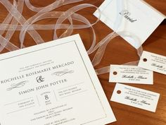 Textured white invitation with silver border plus place cards and gift tags  #fineinvitations #classicweddingstationery