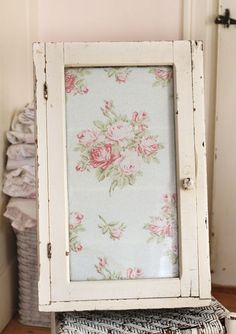Shabby chic vintage medicine cabinet lined with country rose fabric