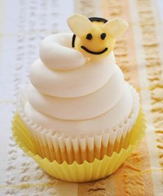 Honey Bee Cupcakes.  British recipe link at bottom of page. Bee made out of marzipan, sliced almonds and piped icing.