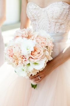 Love this peach, blush Monique Lhuillier wedding dress and pretty bouquet!