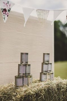 Tin can alley garden game - Image by Lola Rose Photography - Pronovias 'Lary' wedding dress for a vintage inspired wedding in a country house with garden games, 1930s gramophone music & pink colour scheme:
