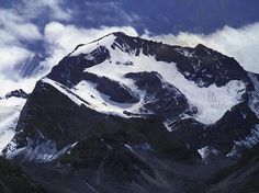 Om Parvat Mountain of the Himalayas.  If you look closely the snow deposition resembles that of the   sacred Hindu syllable ॐ (Om)