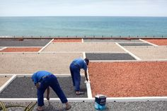 Workers paint the roof of a resort in the luxurious beach district of Ain Diab in Casablanca.