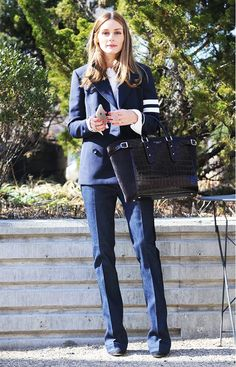 Olivia Palermo goes polished preppy in a navy blazer and tailored jeans