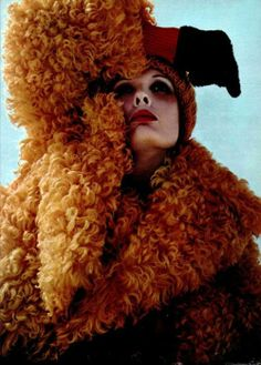 Model wearing a shearling coat for L'Officiel, 1970s.