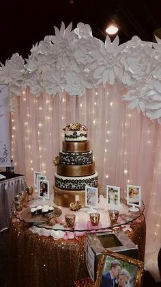 Moments In Time Wedding & Event Rentals ~ 8\' H x 10\' W Pipe & Drape, dressed with white and blush sheers, fairy lights and paper flowers, uplights. Patricia Clark Weddings booth at Holiday Inn Bridal Fair 2016. Please reach us at 406.208.9549 for rental inquiries. Usage: head table, cake table, ceremony altar, photo booth backdrops.
