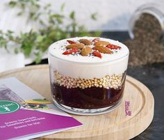 Berry Chia Pudding topped with quinoa pops, soy yoghurt, almonds, gojis and coconut flakes