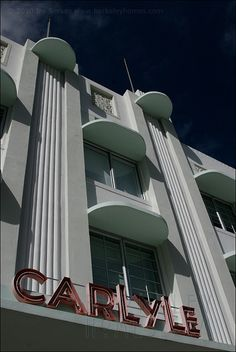 "Rounded cantilevered sun shades known as ""eyebrows"" wrap around windows of the Carlyle Hotel, built in 1941 on Ocean Drive."