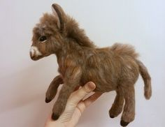 I can now reveal my latest creation, a miniature donkey! I was sent some photos of an absolutely gorgeous real miniature donkey and asked to needle felt her as a surprise Christmas present for her … Needle Felted Animals, Felt Animals, Christmas Presents For Her, Miniature Donkey, Felt Fox, Needle Felting Tutorials, Felt Leaves, Animal Fur, Wet Felting