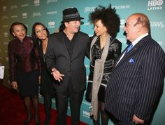 "Congresswoman Nydia Velazquez, Lucinda Martinez, Carlos Santana, wife Cindy Blackman Santana and Clive Davis attend the HBO Latino NYC Premiere of ""Santana: De Corazon"" (Photo by Jerritt Clark/Getty Images for HBO Latino)"
