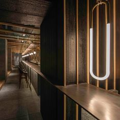 """Chinese studio Neri&Hu has designed a long communal table and suspended lighting that creates a """"canopy"""" in the atrium of Shanghai's Chi-Q restaurant."""