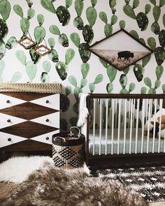 painted cactus wallpaper in the nursery