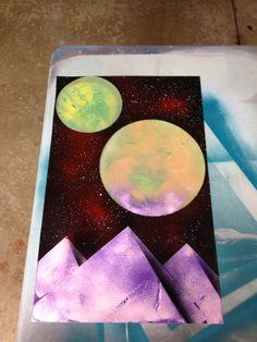 Spray paint art - Purple pyramids.