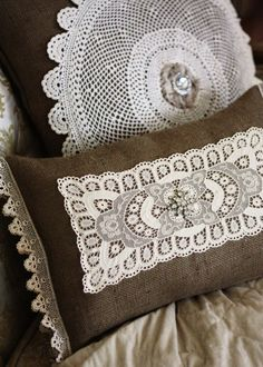 burlap pillows with lace, doily's, and crystal details.
