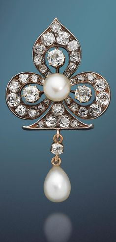 An antique natural pearl and diamond trefoil brooch, circa 1895.  Designed as an openwork trefoil with knifewire detail, set throughout with cushion-shaped diamonds, centrally set with a 5.7mm x 8.1mm bouton pearl, suspending a similarly-shaped diamond and an 8.0mm x 12.3mm pearl drop, mounted in silver and gold,  three principal diamonds approx. 1.20cts total, remaining diamonds approx. 3.00cts total, length 5.4cm. #antique