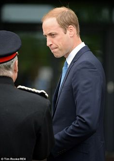 Listening hard: The Duke looked grave as he listened to members of the Scottish Air Ambulance