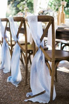 How lovely is this flowing fabric on a cross back chair...so pretty! Pastel Spring Wedding Reception: French Blue, soft peach, farm tables, cross back chairs Nashville Garden Wedding Venue & Design: CJ's Off the Square Flowers: The Enchanted Florist Photographer: Jen & Chris Creed Rentals: Southern EventsReception, Jen + Chris Creed-004