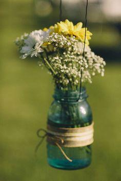 Wedding flowers in mason jar