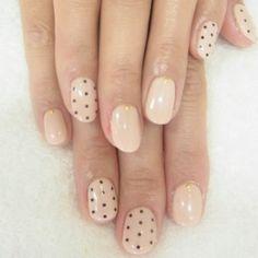 beige with black polka dot nails
