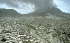 Plymouth, the former capital city and major port of Montserrat on 12 July 1997, after pyroclastic flows burned much of what was not covered in ash.