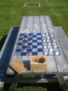 Picnic table games. Lets spray paint checkers and tic tac toe on fabric for a sit down game area