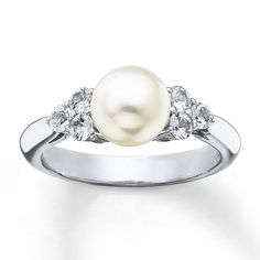 This sterling silver ring, from the Sea Magic Cultured Pearls® by Mikimoto collection, features a marvelous 7mm Akoya cultured pearl with three round natural white sapphires on each side. Sapphire is commonly subjected to enhancement processes or treatments such as heating and diffusion. Gently clean by rinsing in warm water and drying with a soft cloth.
